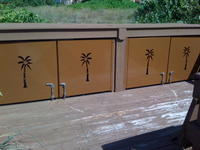 CONDO BEACH ACCESS STORAGE DOORS FORMED OUT OF ALUM. WITH CNC PLASMA PALM TREE CUTOUTS